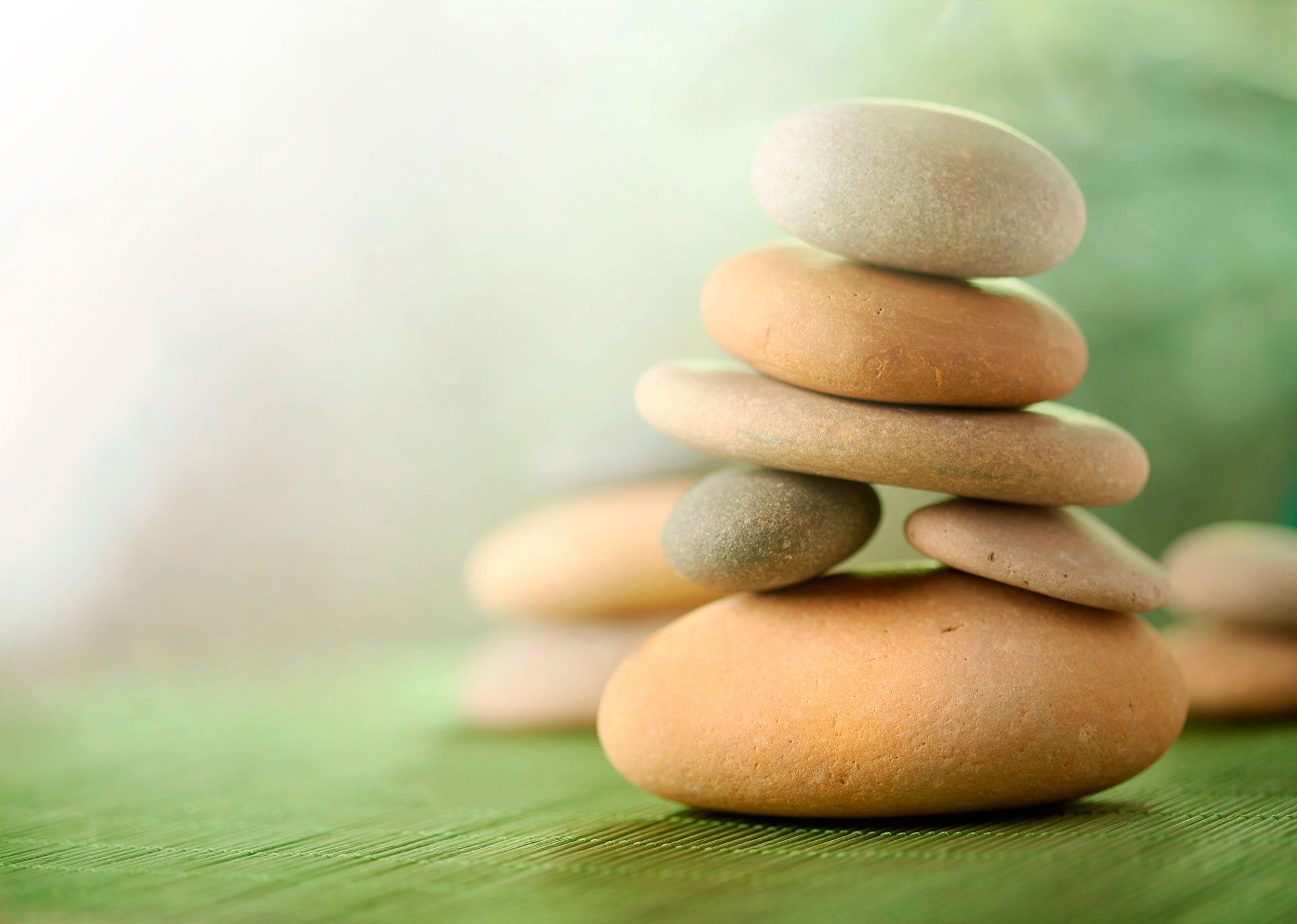 stacked-stones-on-mat-retreats_web