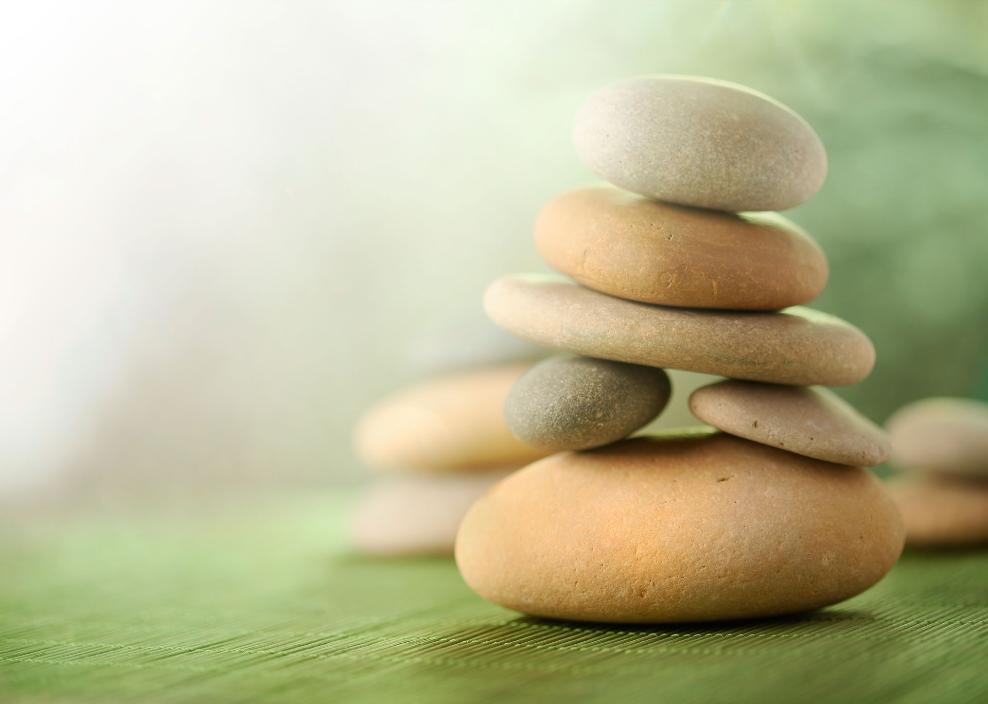 stacked-stones-on-mat-13471154_web